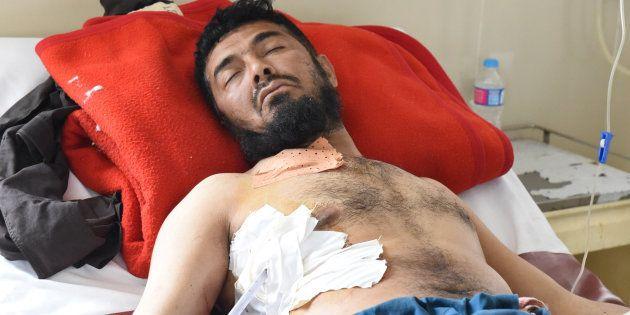 Un Pakistanais blessé près de la frontière et hospitalisé à Quetta, le 5 mai. Afghans et Pakistanais...