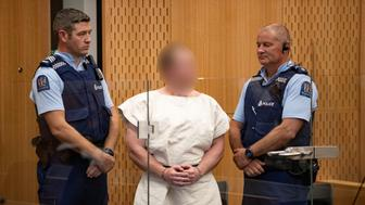 Brenton Tarrant, charged for murder in relation to the mosque attacks, is seen in the dock during his appearance in the Christchurch District Court, New Zealand March 16, 2019.   Mark Mitchell/New Zealand Herald/Pool via REUTERS. ATTENTION EDITORS - PICTURE PIXELATED AT SOURCE. SUSPECT FACE MUST BE PIXELATED. ONLY HIS FACE.
