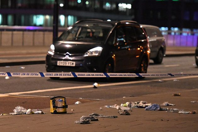 Debris and abandoned cars remain on London at the scene of an apparent terror attack on London Bridge...
