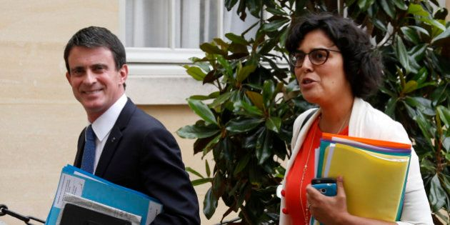 French Prime Minister Manuel Valls (L) and Labour Minister Myriam El Khomri arrive before a series of...