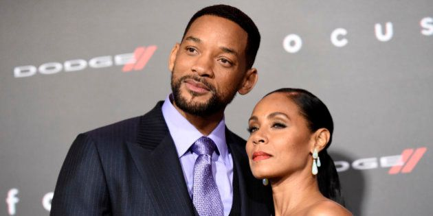 Will Smith, left, and Jada Pinkett Smith arrive at the world premiere