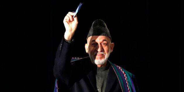 Élection présidentielle en Afghanistan: huit candidats, dont celui d'Hamid Karzaï, et trois favoris pour...