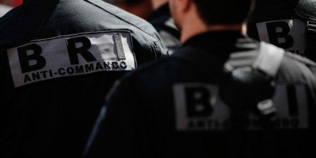 Members of the elite BRI police force listen to French Interior Minister Bernard Cazeneuve in Paris,...