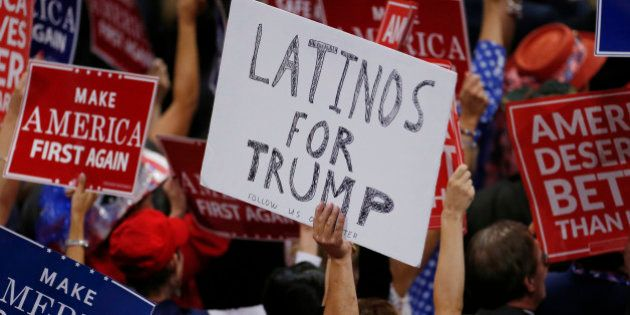 A person holds a sign reading 'Latinos for Trump' on the third day of the Republican National Convention...