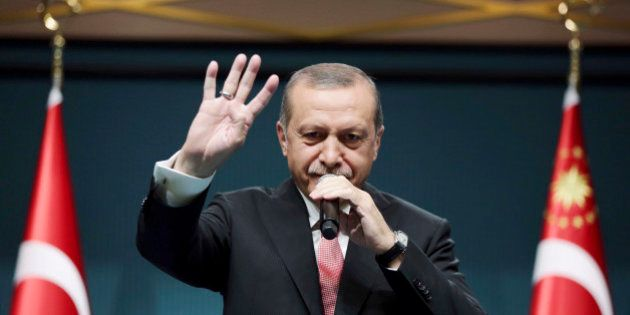 Turkey's President Recep Tayyip Erdogan speaks after an emergency meeting of the government in Ankara,...