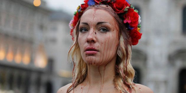 Inna Shevchenko, a member of the Ukrainian feminist protest group FEMEN, stages a protest in front of...
