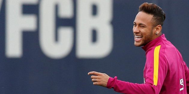 FC Barcelona's Neymar smiles during a training session at the Sports Center FC Barcelona Joan Gamper...