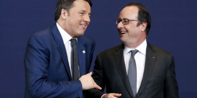 Italy's Prime Minister Matteo Renzi and France's President Francois Hollande (R) pose for a family photo...