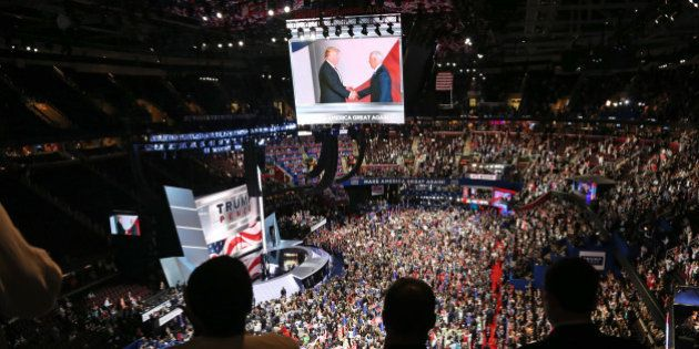 People watch a television monitor from the upper seats as U.S. Republican Presidential nominee Donald...