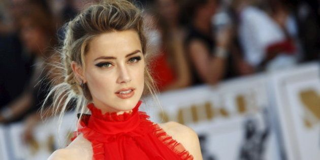 Actress Amber Heard poses at the European premiere