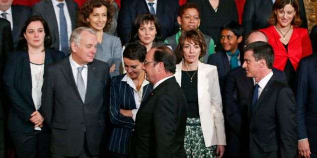 French President Francois Hollande (C) followed by Prime Minister Manuel Valls (R) arrive to attend a...