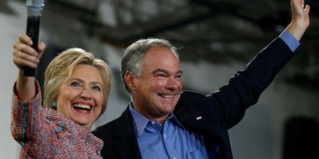 Democratic U.S. presidential candidate Hillary Clinton and U.S. Senator Tim Kaine (D-VA) wave to the...