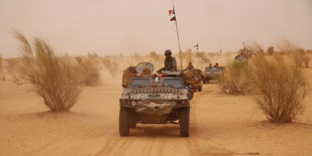 In this photo taken June 24, 2015, French forces patrol in the desert of Northern Mali along the border...