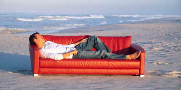 Man lying on sofa at