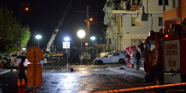 Turkish forensic police officers work at the site of an explosion at a police station in Istanbul's Sultanbeyli...
