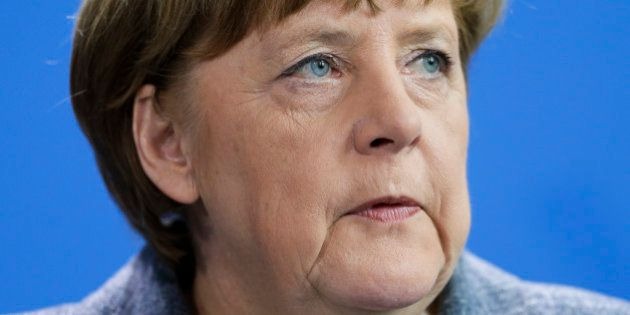 German Chancellor Angela Merkel speaks to media during a statement at the chancellery in Berlin, Friday,...