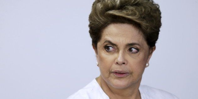 Brazil's President Dilma Rousseff looks on during signing of federal land transfer agreement for the...