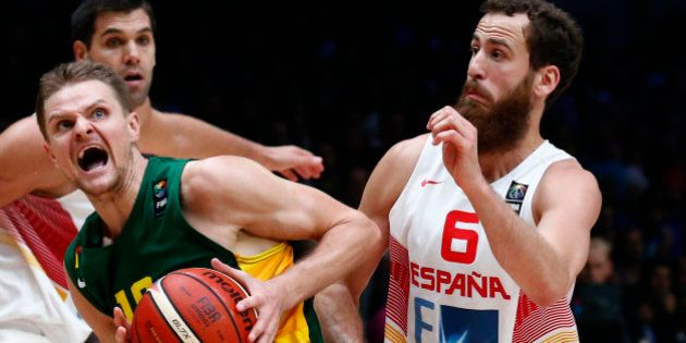 Lithuania's Renaldas Seibutis (L) goes up for a basket over Spain's Sergio Rodriguez during the EuroBasket...