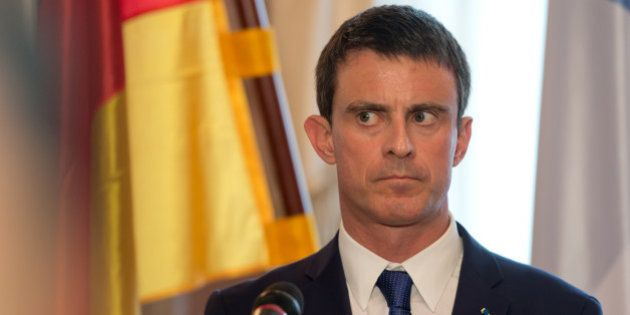 France's Prime Minister Manuel Valls listens to a question during a press conference after a meeting...