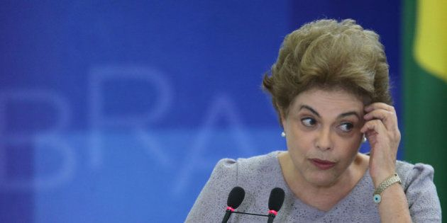 Brazil's President Dilma Rousseff speaks during a meeting of pro-government lawyers at the Planalto...
