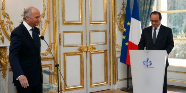 French President Francois Hollande (R) listens to newly named President of the Constitutional Council...