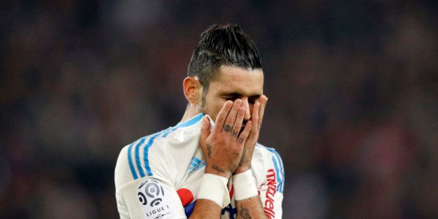 Olympique Marseille's Remy Cabella reacts at the end of his French Ligue 1 soccer match against Paris...
