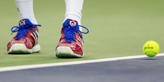SHANGHAI, CHINA - OCTOBER 18: A detail of Novak Djokovic of Serbia shoes as he serves against Jo-Wilfried...