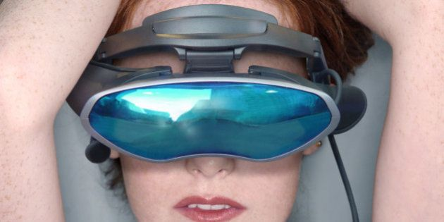 Nude woman wearing virtual reality goggles