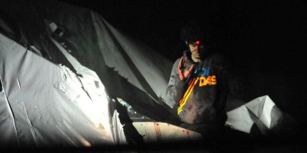 PHOTOS. Attentats de Boston : de nouvelles images de l'arrestation de Djokhar Tsarnaev font