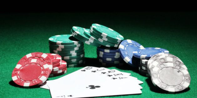 Cards and chips for poker on green