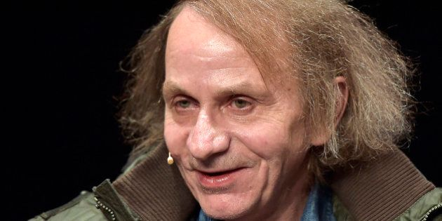 French novelist and poet Michel Houellebecq smiles towards the audience prior to a reading of his latest...