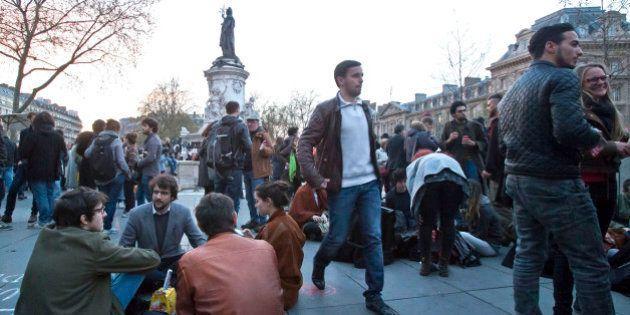 People gather on the Place de la Republique, in Paris, France, Wednesday, April 13, 2016. Thousands of...