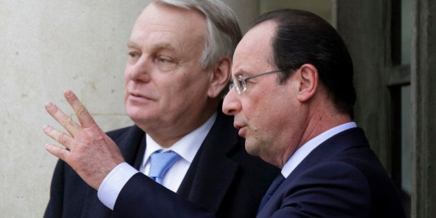 French President Francois Hollande (R) speaks with Prime Minister Jean-Marc Ayrault after a joint Franco-German...