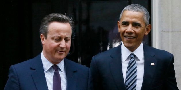 U.S President Barack Obama, right, and Britain's Prime Minister David Cameron walk from 10 Downing Street,...