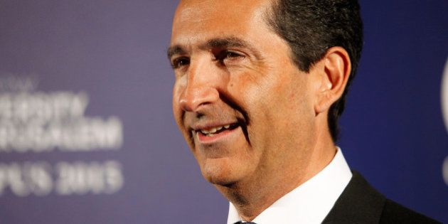 Altice group's Chairman Patrick Drahi poses for photographers at the Scopus Awards of the French Friends...