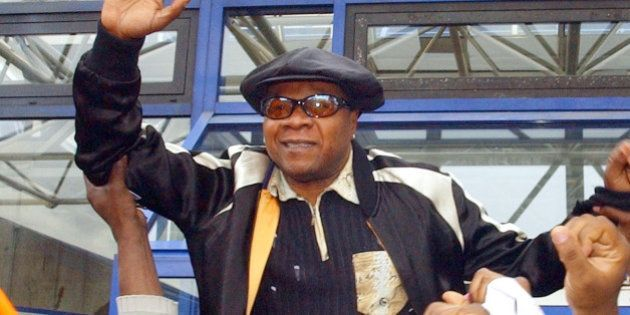 Congolese pop star Papa Wemba is hoisted by supporters as he leaves the courthouse in Bobigny near Paris...