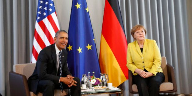 German Chancellor Angela Merkel and U.S. President Barack Obama pose before bilateral talks at Schloss...