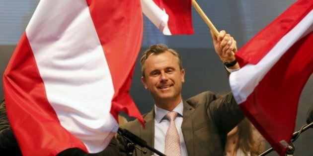 Austrian far right Freedom Party (FPOe) presidential candidate Norbert Hofer waves with Austrian flags...