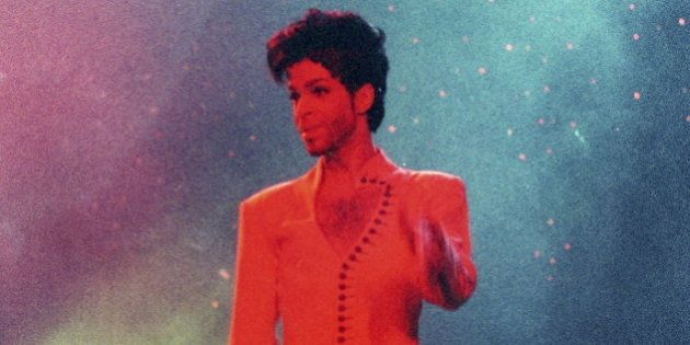 Prince performs during his 'Diamonds and Pearls Tour' at the Earl's Court Arena in London, Britain, June...