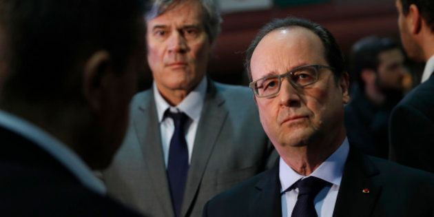French President Francois Hollande and Agriculture Minister Stephane Le Foll, background, visit the Agriculture...