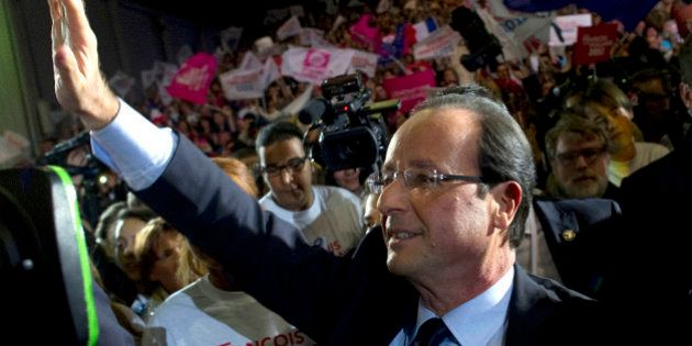 France's Socialist Party candidate for the 2012 French presidential elections, Francois Hollande, arrives...
