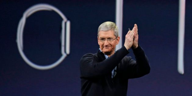 Apple CEO Tim Cook applauds at the conclusion of the