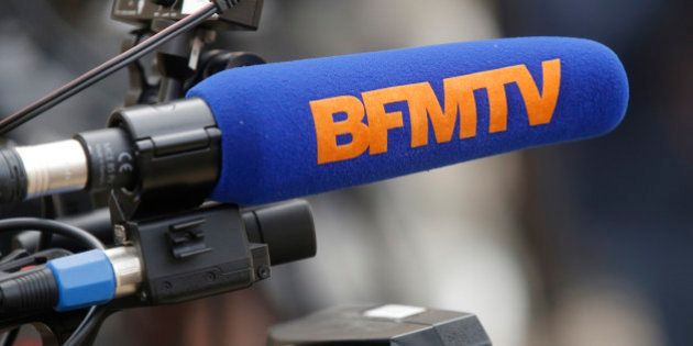 A microphone of French TV channel BFMTV is seen in the courtyard of the Elysee Palace in Paris, March...