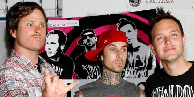 Blink-182 band members (L-R) guitarist/vocalist Tom Delonge, drummer Travis Barker and bassist/vocalist...