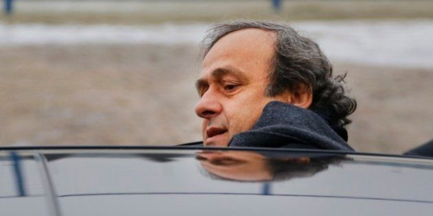 FILE - In this Jan. 19, 2015 file photo UEFA President Michel Platini gets into a car after a visit to...