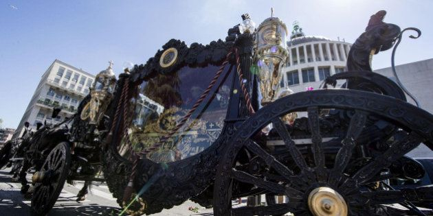 A horse-drawn carriage containing the coffin of purported mafia boss Vittorio Casamonica is driven past...