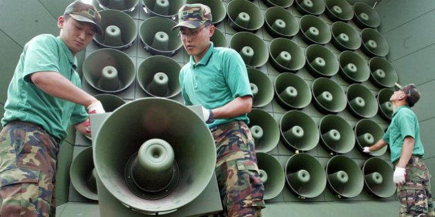 South Korean soldiers remove loudspeakers used for propaganda near the demilitarized zone between South...