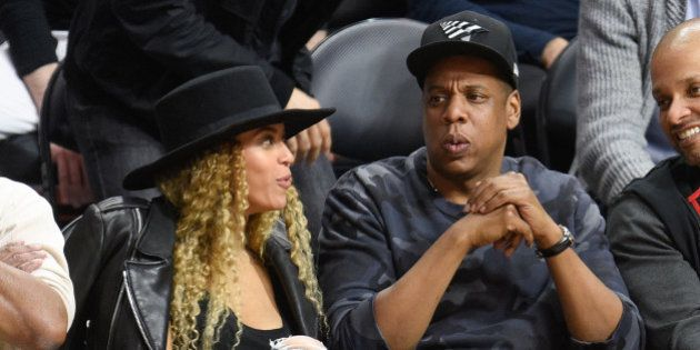 LOS ANGELES, CA - MARCH 02: Beyonce (L) and Jay-Z attend a basketball game between the Oklahoma City...
