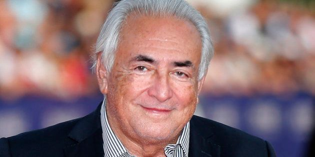 FILE - This Saturday, Sept. 13, 2014, file photo shows former IMF Secretary General Dominique Strauss-Kahn arriving for the award ceremony at the 40th American Film Festival in Deauville, Normandy, western France. The French economist known universally by his initials DSK, faces up to 10 years in prison and a 1.5 million euro ($1.7 million) fine on charges of aggrevated pimping, along with over a dozen other French and Belgian businessmen and police officers at the trial beginning Monday at a courthouse in the northern French city of Lille. (AP Photo/Jacques Brinon, File)