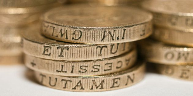 Macro study of a bunch of £1 pound coins PERMISSION TO USE: you are welcome to use this photo free of...